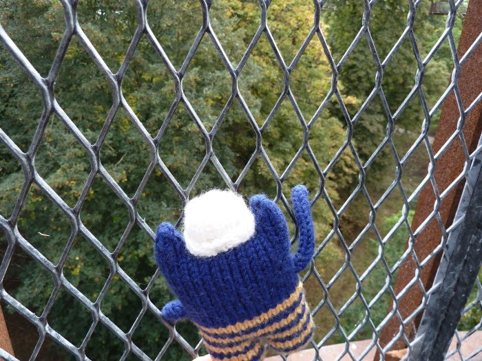 Explorer Beastie scaling the fence