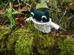 Paddy checks out some moss - CrawCrafts Beasties/Heather Crawford