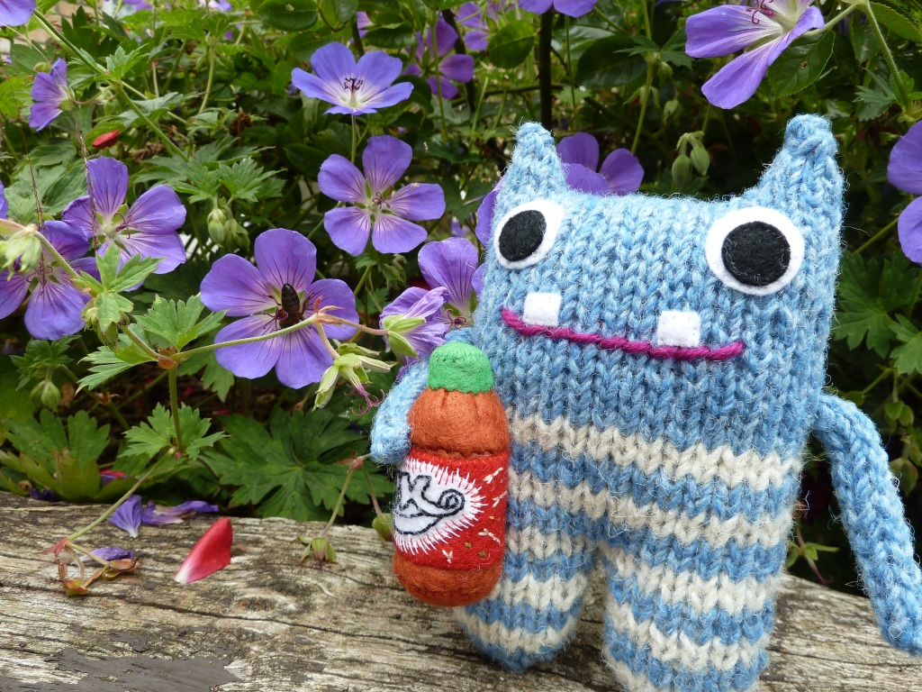 Red Lemonade Beastie in the Garden - CrawCrafts Beasties