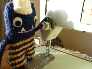 Explorer Beastie Checks the Sewing Machine - CrawCrafts Beasties