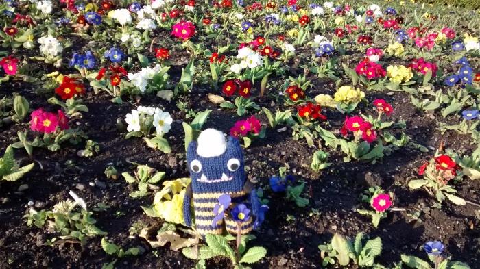 Explorer Beastie Enjoys the Spring Flowers - CrawCrafts Beasties