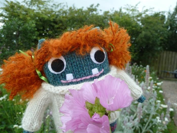 Redhead Beastie among the flowers - CrawCrafts Beasties