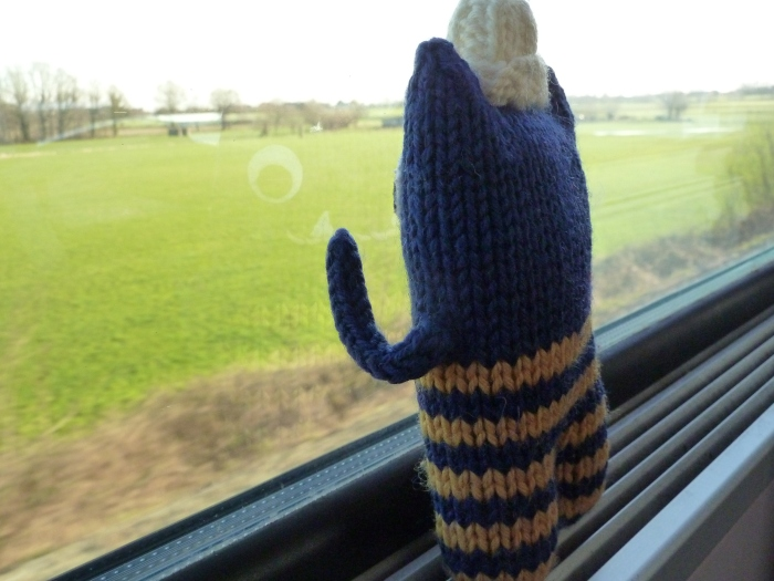 Taking the train with Explorer Beastie - CrawCrafts Beasties