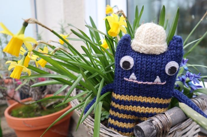 Explorer Beastie with Spring Daffodils - CrawCrafts Beasties